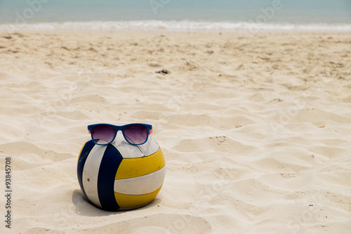 Poster a Volleyball at the Summer Beach with a Sunglass