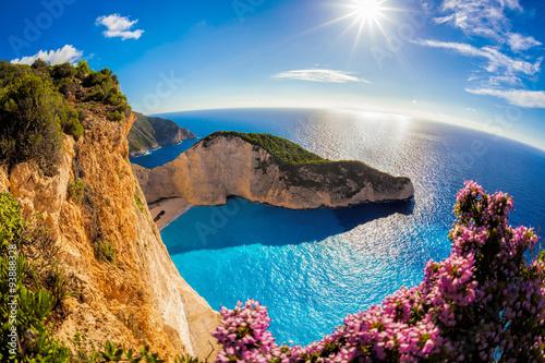 Zdjęcia na płótnie, fototapety, obrazy : Navagio beach with shipwreck and flowers against sunset, Zakynthos island, Greece