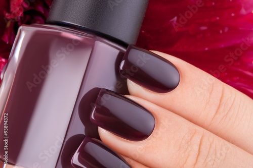 Dark red nail polish.