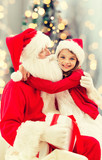 Fototapety smiling little girl with santa claus