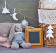 Elegant style still life with interior Christmas decoration elements and rabbit toy