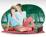 relaxing in nature /  Happy young couple enjoying picnic