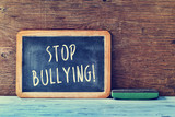 text stop bullying in a chalkboard poster