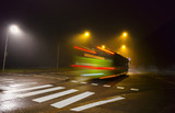 green bus in dark foggy autumn evening - 93957170