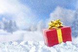 Fototapety Gift box on snow at Christmas outside