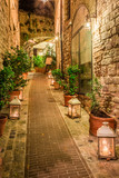 Fototapeta Uliczki - Beautiful decorated street in small town in Italy, Umbria © shaiith