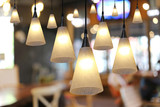 Warm lighting modern ceiling lamps in the cafe. - 94040789