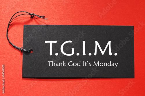 TGIM text on a black tag