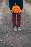 Holding a Halloween pumpkin