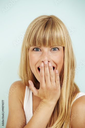 Shocked young woman in blue studio © sanneberg
