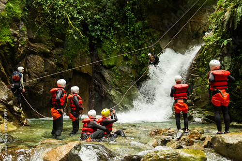 Team Of Mixed People On Canyoning Adventure
