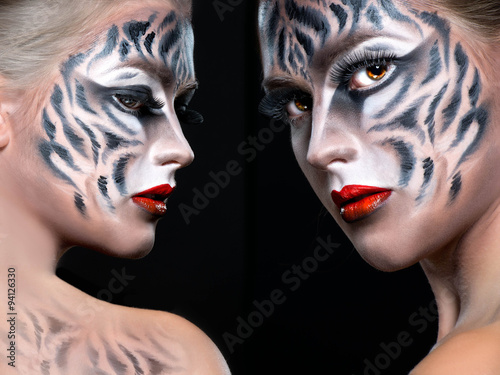Obraz w ramie Woman with tiger face in halloween concept