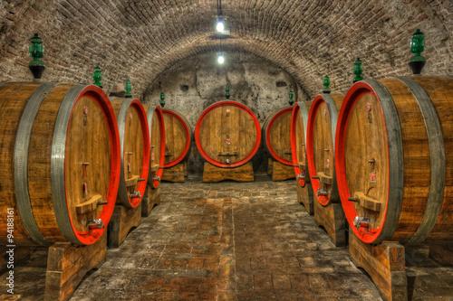 Zdjęcia na płótnie, fototapety na wymiar, obrazy na ścianę : Cellar with barrels of wine