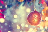 Fototapety Christmas and New Year decoration. Golden bauble hanging on Christmas Tree