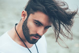 Fototapety Portrait of a man with beard and modern hairstyle