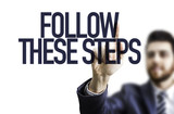 Business man pointing the text: Follow These Steps