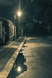 Fototapety Night scene after rain - lantern lights and puddle, old street