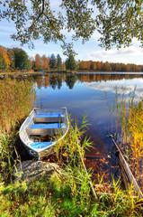 Vertical autumn landscape with aluminium boat © Piotr Wawrzyniuk
