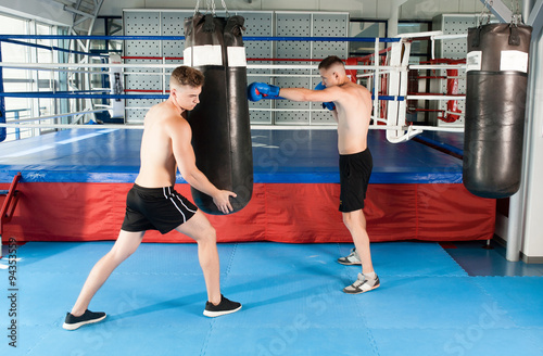 Fototapeta Strong boxer and opponent during a box fight in ring