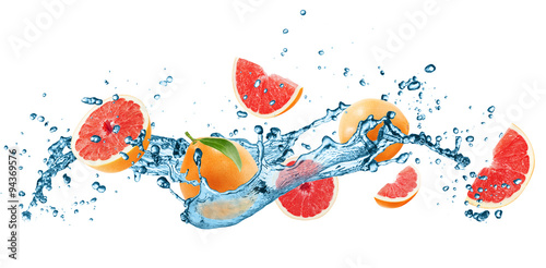 grapefruets in water splash isolated on the white background