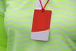 Closeup blank name tag hang on volunteer staff in golf tournamen