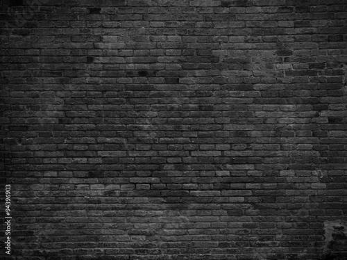 Part of black painted brick wall. Empty
