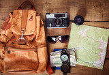 travel equipment -  map, backpack, vintage camera, sunglasses, compass, passport and money
