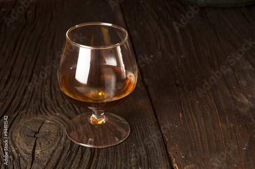 Poster Glasses of brandy in cellar with old barrels