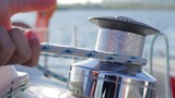 Tensioning sail yacht. Winch on sailing yacht.