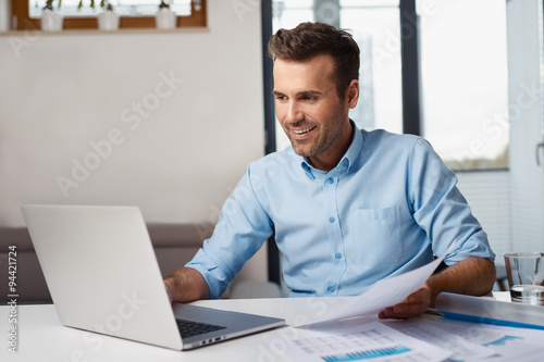 Poster Man working from home on laptop