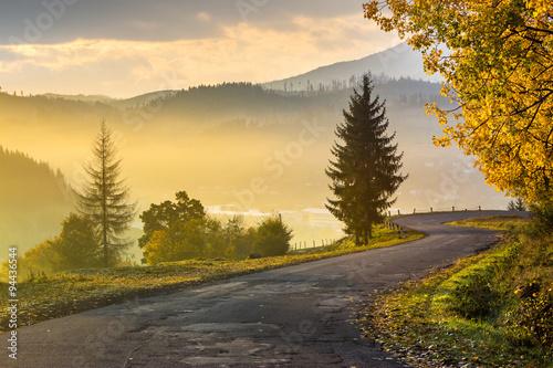 fototapeta na ścianę mountain road to village in mountains