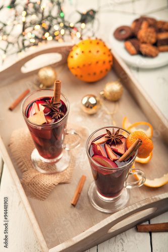 Hot mulled drink with cinnamon, anise and apples