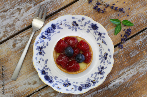 Photo: Crunchy tartelette with fresh fruit on vintage plate on rustic ...