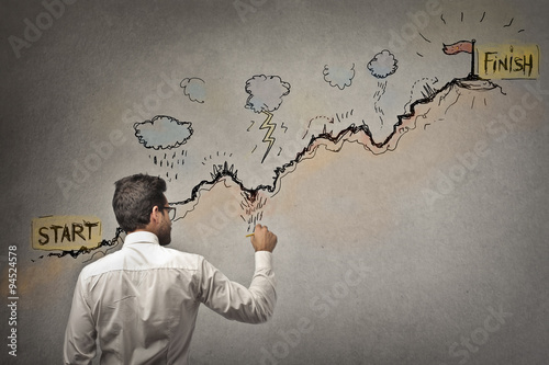 Businessman trying to reach his target