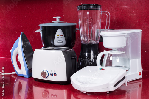 Poster Household appliances in modern kitchen red background