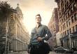 Obrazy na płótnie, fototapety, zdjęcia, fotoobrazy drukowane : Man walking in the city