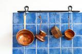 Kitchen interior, accessories. Hanging copper kitchenware set.