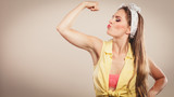 Happy pretty pin up girl showing off muscles. - 94615394