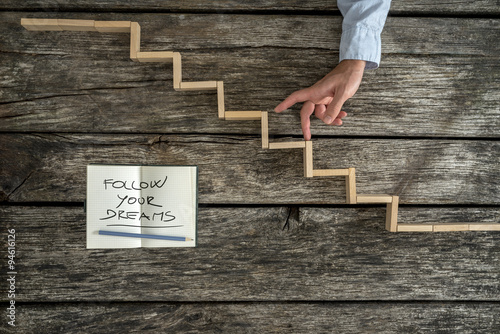 Poster Male hand walking his fingers up wooden steps with a Follow your