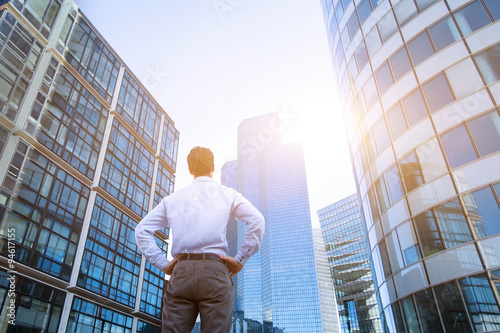 Poster career concept, business background, man looking at office buildings