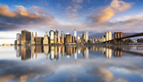 Fototapety New York City - beautiful sunrise over manhattan with manhattan and brooklyn bridge USA