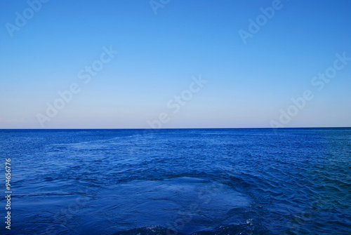 Poster Oceanië Mediterranean Sea Background. Blue Water. Waves on the Surface.