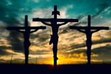 Fototapety Silhouette of Jesus with Cross over sunset concept for religion,