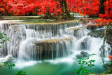 Fototapety Amazing waterfall in autumn forest
