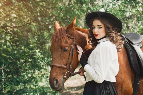 Woman in vintage dress with horse