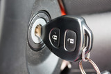 car key inserted into the lock of ignition of the car