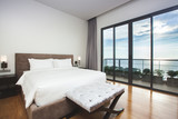 Fototapety Modern comfortable, nicely decorated bedroom with seascape view