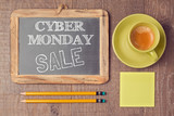 Cyber Monday on chalkboard with coffee cup. Holiday online shopping concept. View from above