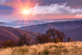 Colorful sunrise in the autumn mountains.