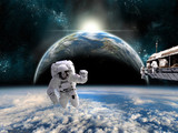 A team of astronauts work on a space station - Elements of this image furnished by NASA. - 94801519